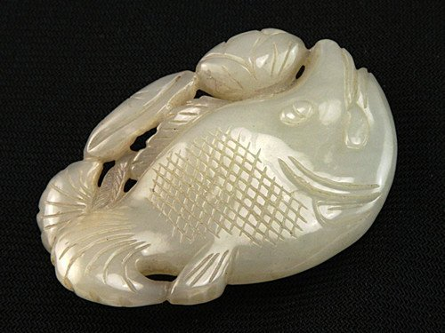 18: An Antique White Jade Pendant
