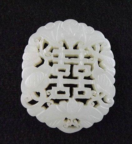 20: An Antique White Jade Pendant