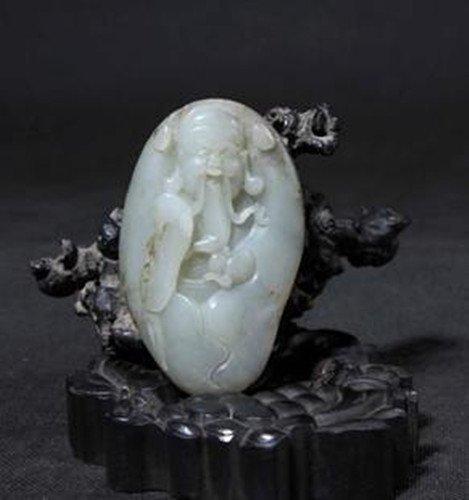 A Fine White Jade Carved Figure