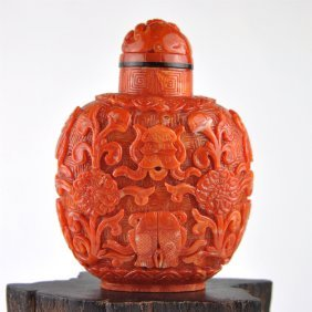 A Red Coral Carved Snuff Bottle