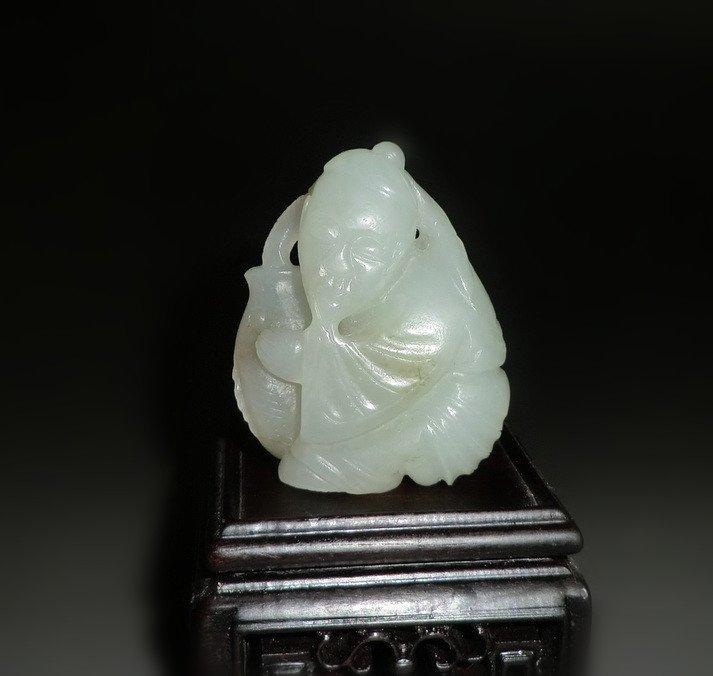 An Old Celadon Jade Carving