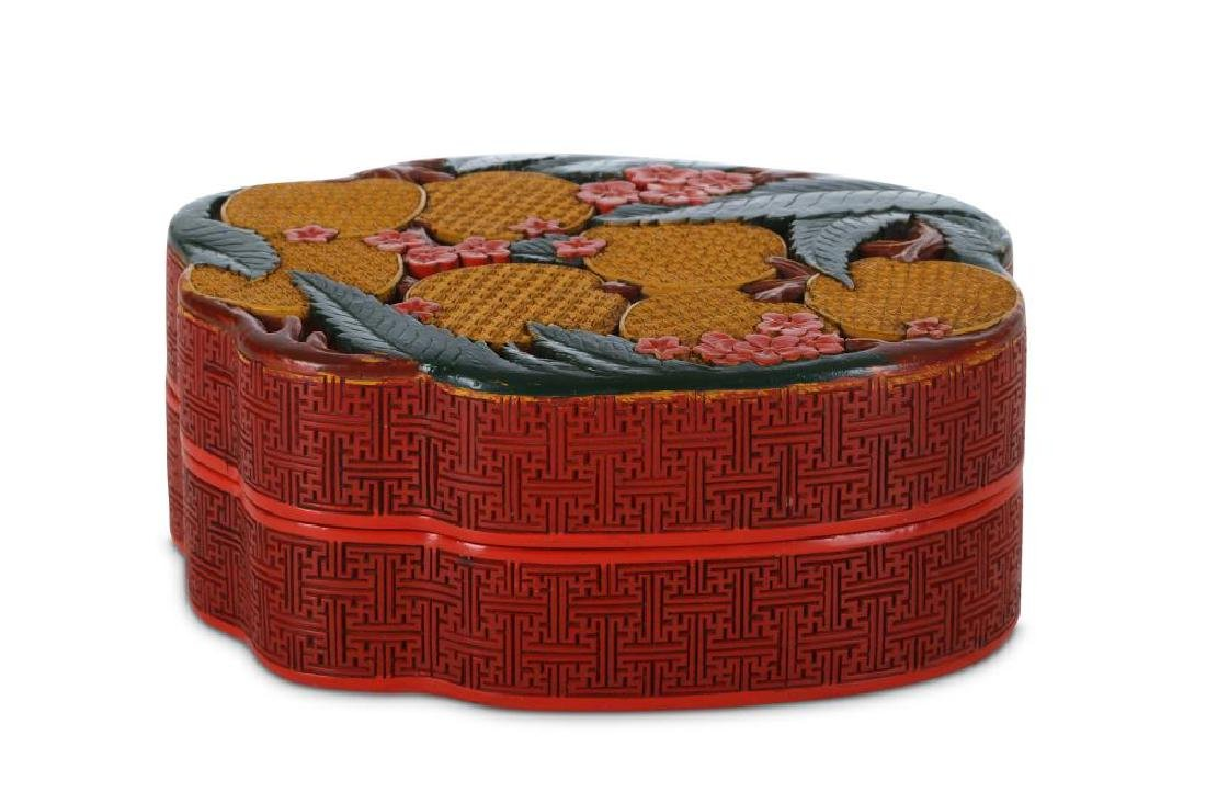 A CHINESE CINNABAR LACQUER BOX AND COVER. 20th Century.