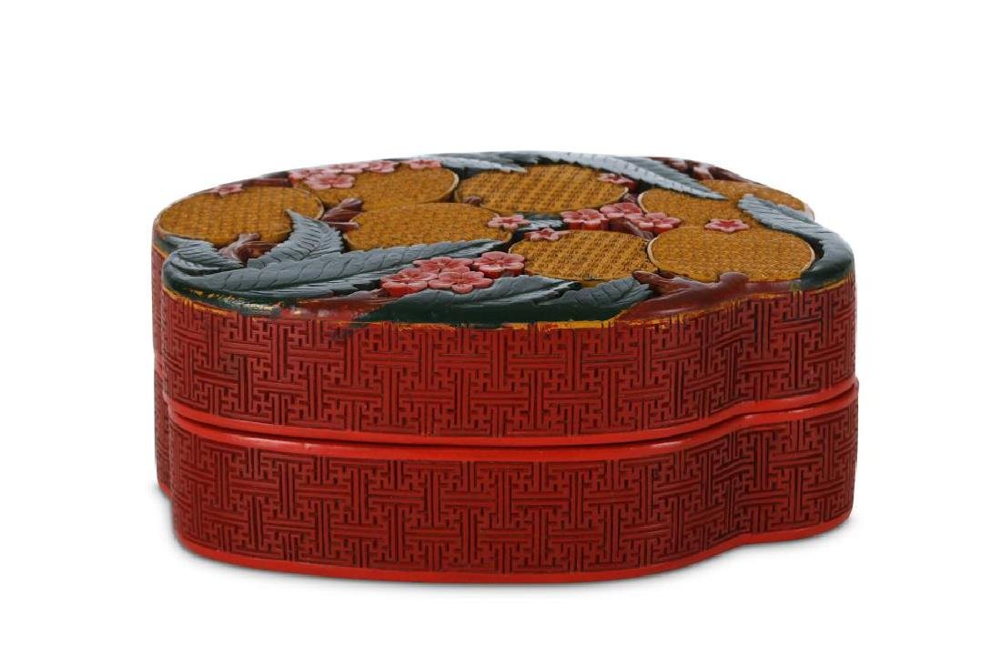 A CHINESE CINNABAR LACQUER BOX AND COVER. 20th Century. - 2