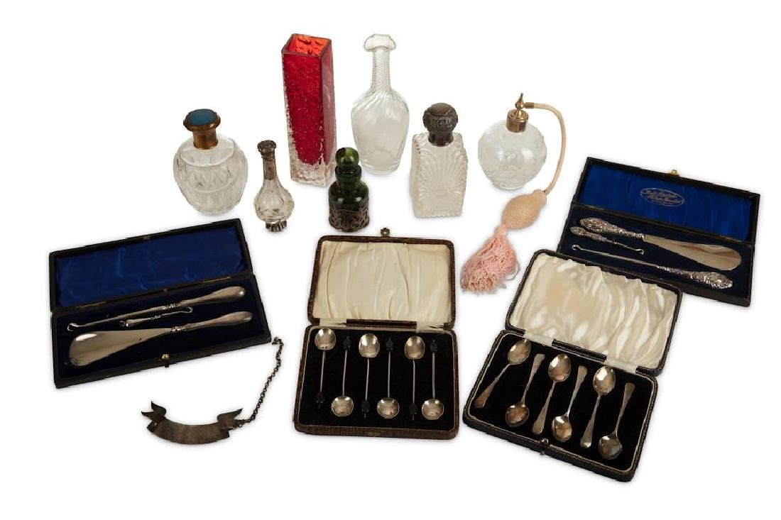 A collection of silver and perfume bottles