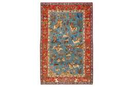 A VERY FINE SIGNED PART SILK QUM RUG OF HUNTING DESIGN,