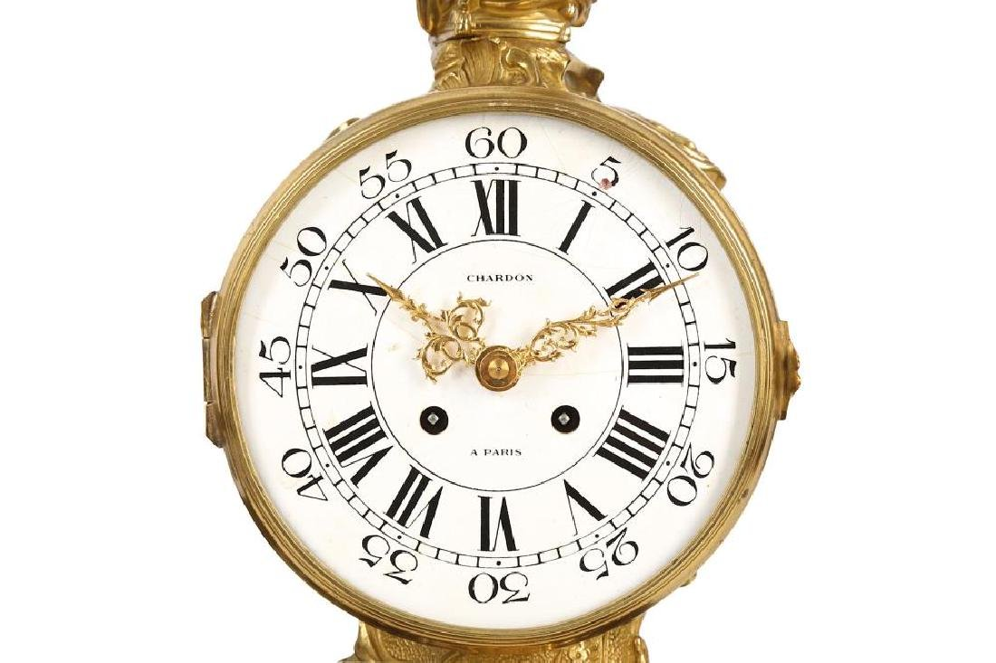 A LOUIS XV STYLE GILT AND PATINATED BRONZE MANTEL CLOCK - 2