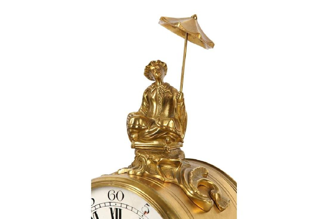 A LOUIS XV STYLE GILT AND PATINATED BRONZE MANTEL CLOCK - 7
