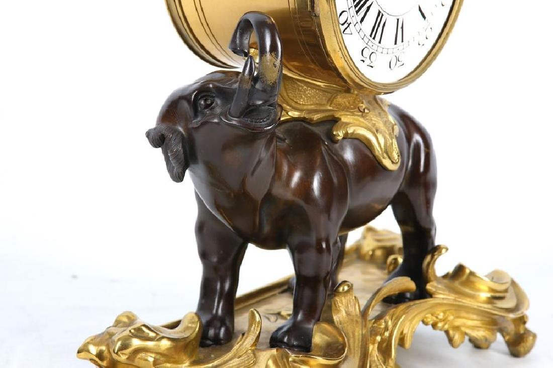 A LOUIS XV STYLE GILT AND PATINATED BRONZE MANTEL CLOCK - 8