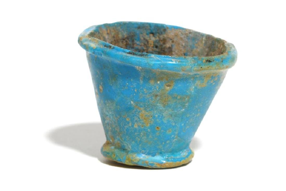 AN EGYPTIAN BLUE GLAZED COMPOSITION VESSEL Late Period,
