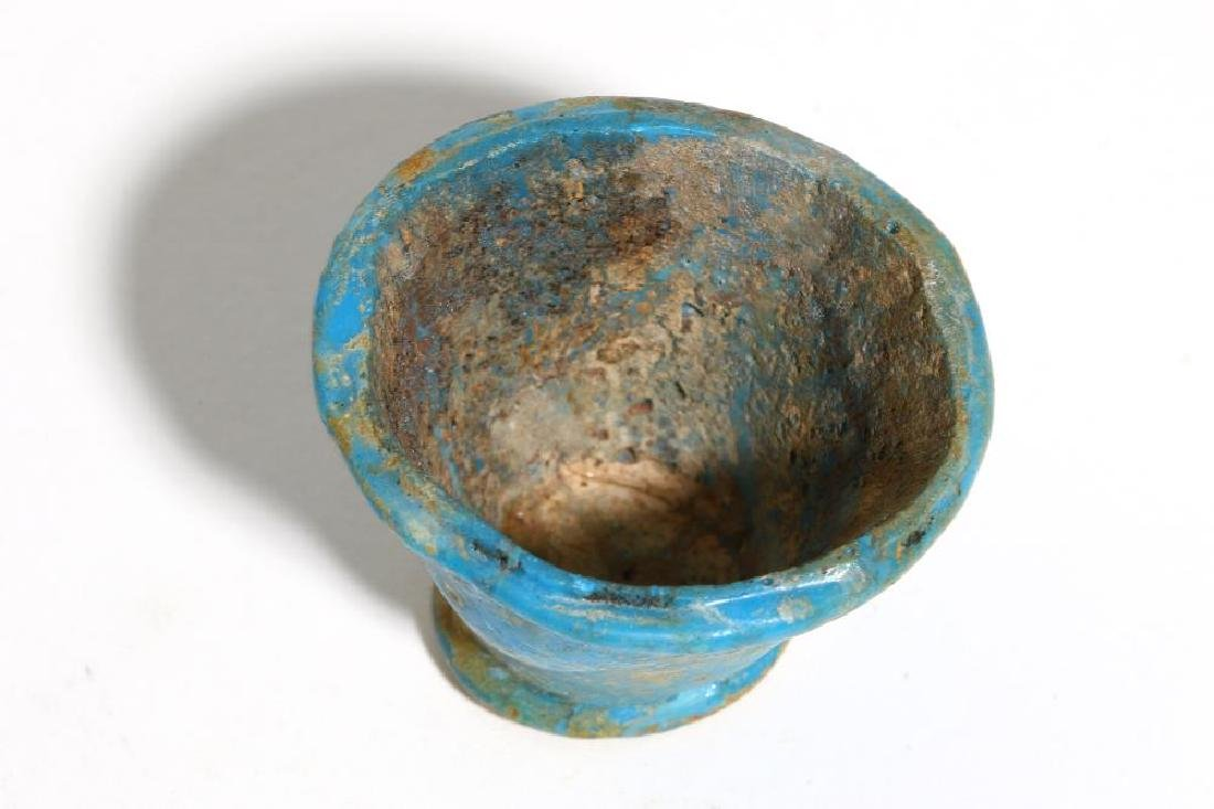 AN EGYPTIAN BLUE GLAZED COMPOSITION VESSEL Late Period, - 3