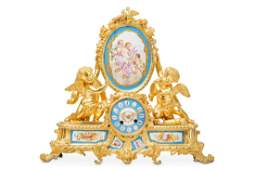 A 19TH CENTURY FRENCH GILT BRONZE AND PORCELAIN MOUNTED