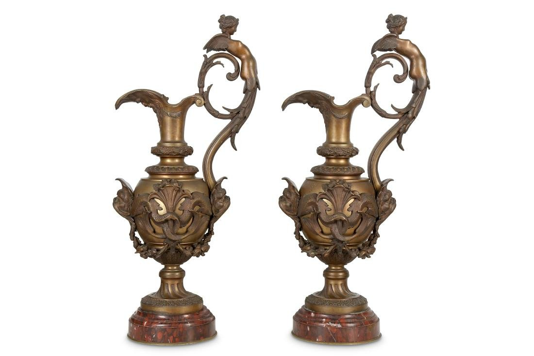 A LARGE PAIR OF NAPOLEON III PERIOD BRONZE EWERS BY