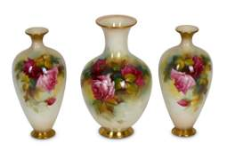 Three Royal Worcester porcelain vases each decorated by
