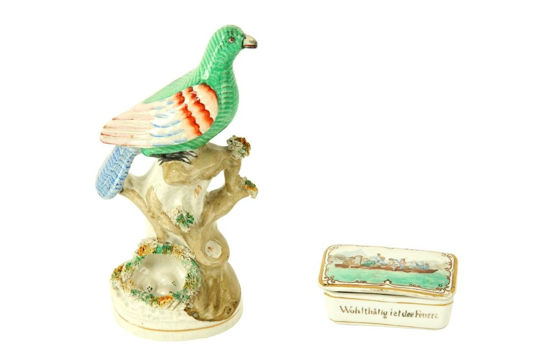A Victorian Staffordshire figure of a colourful bird