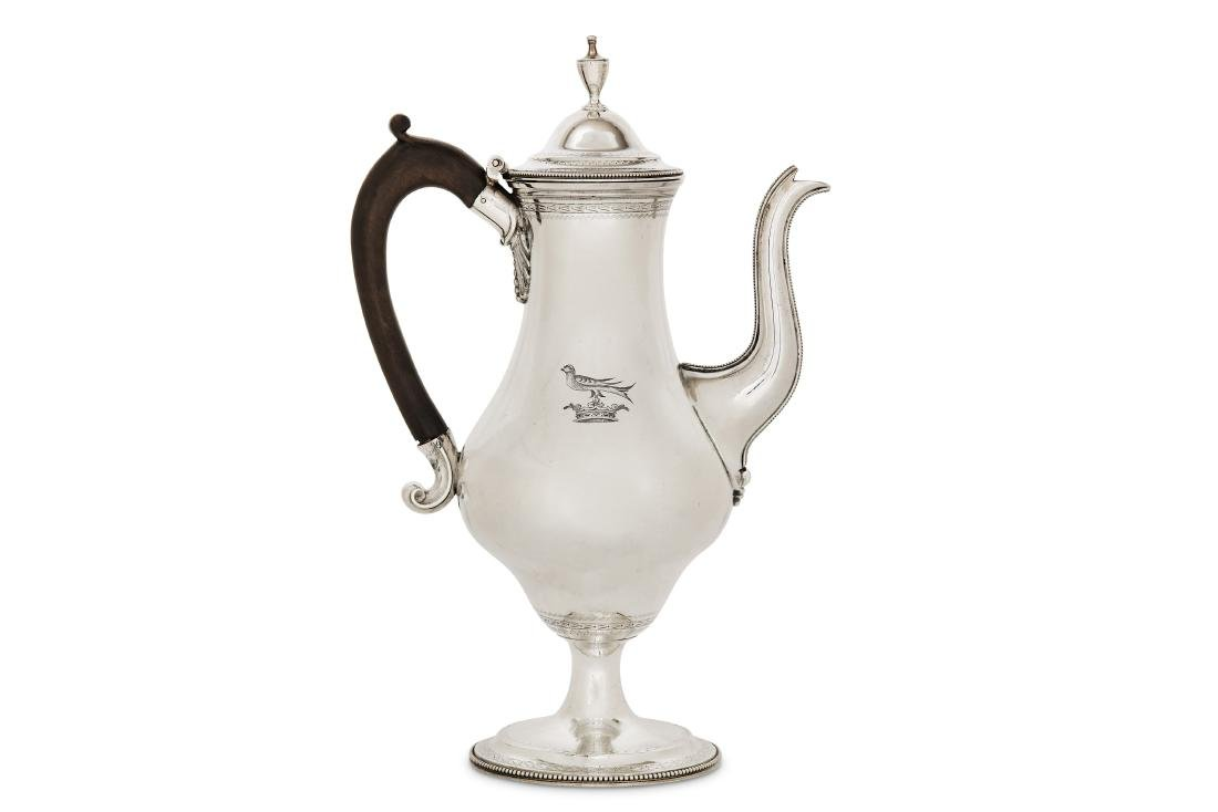 A George III sterling silver coffee pot, London 1783 by