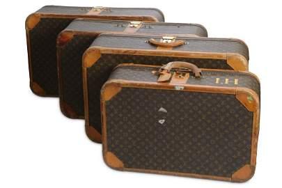 Four Louis Vuitton Stratos Suitcases
