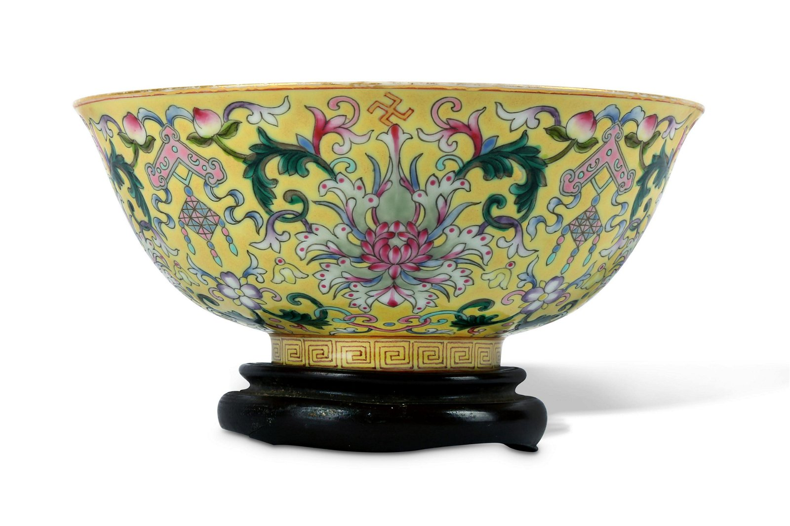 A CHINESE YELLOW GROUND FAMILLE ROSE 'LOTUS' BOWL.