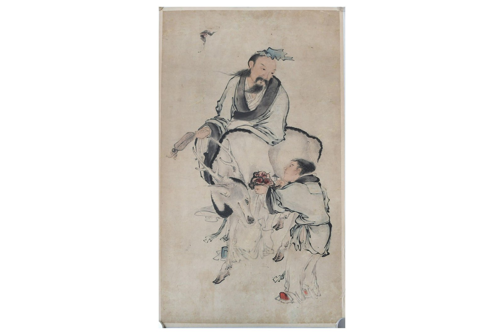 A CHINESE PAINTING OF A SCHOLAR AND A DEER.