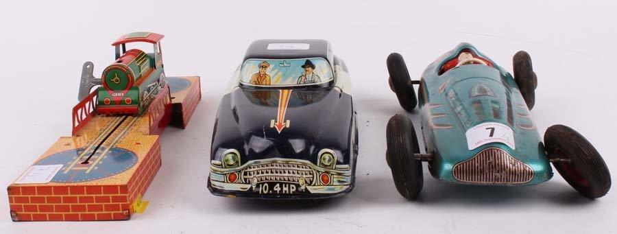 7: Three tin toys including a TCO Racing Car, a frictio