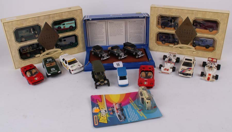 16: A quantity of boxed and unboxed die-cast cars inclu