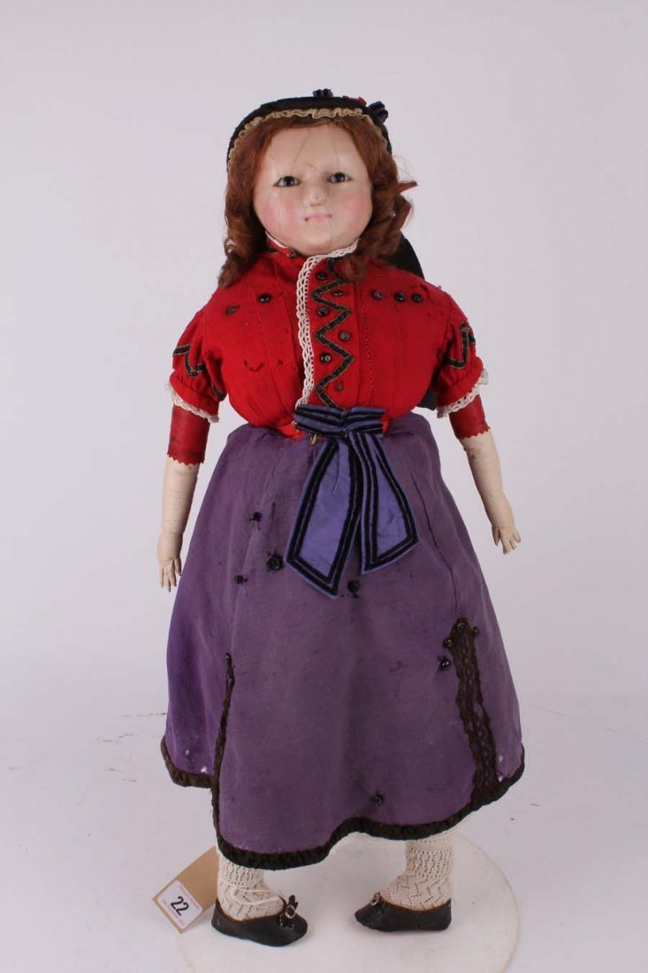 22: A large wax over papier maché child doll, English 1
