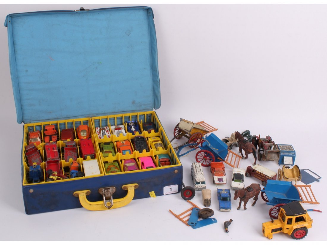 1: A Matchbox 1971 carry case full of cars, with three