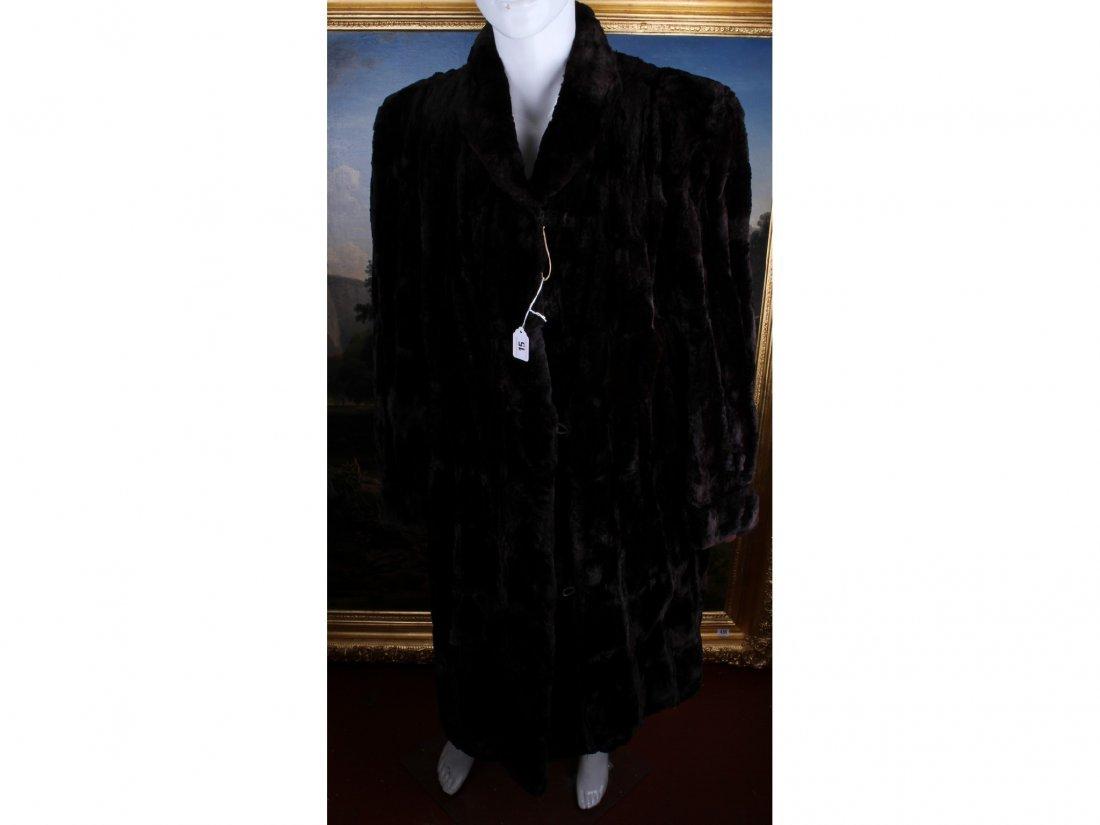 15: A vintage dark brown moleskin fur coat (possibly si