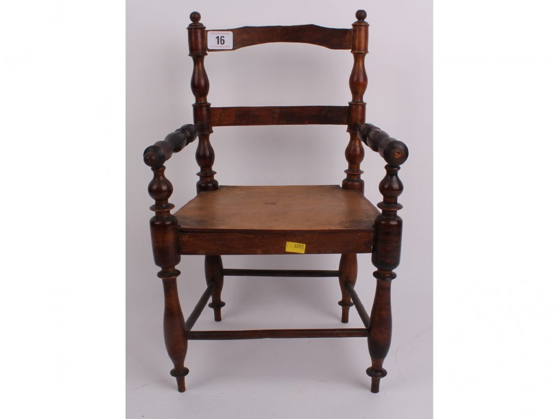 16: A small antique chair suitable for a doll, having n