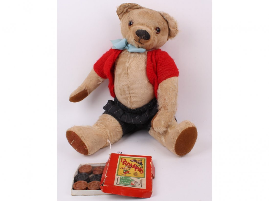 23: A character blonde mohair Teddy bear, dressed, Engl