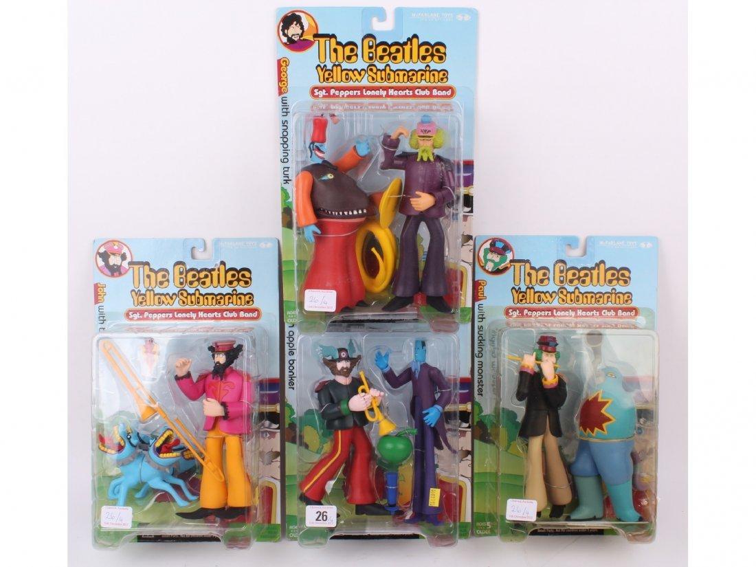 26: Four vintage 'The Beatles Yellow Submarine' figures
