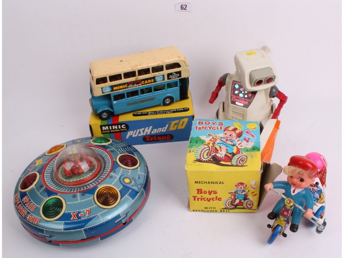 62: Three vintage tin toys and a Tony Robot, battery op