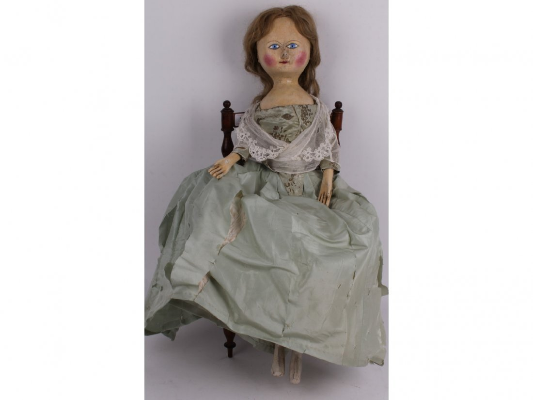 167: A large and rare George III carved wooden doll, En