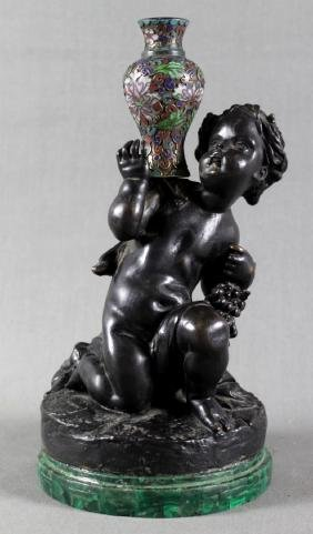 FRENCH PATINATED BRONZE AND ENAMEL FIGURE OF A BOY W/