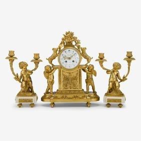 19th Century French Louis XV style gilt bronze clock