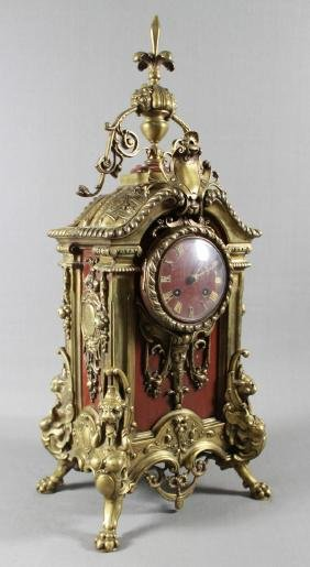 A 19TH C. FRENCH ROUGE MARBLE AND GILT BRONZE MANTLE CL