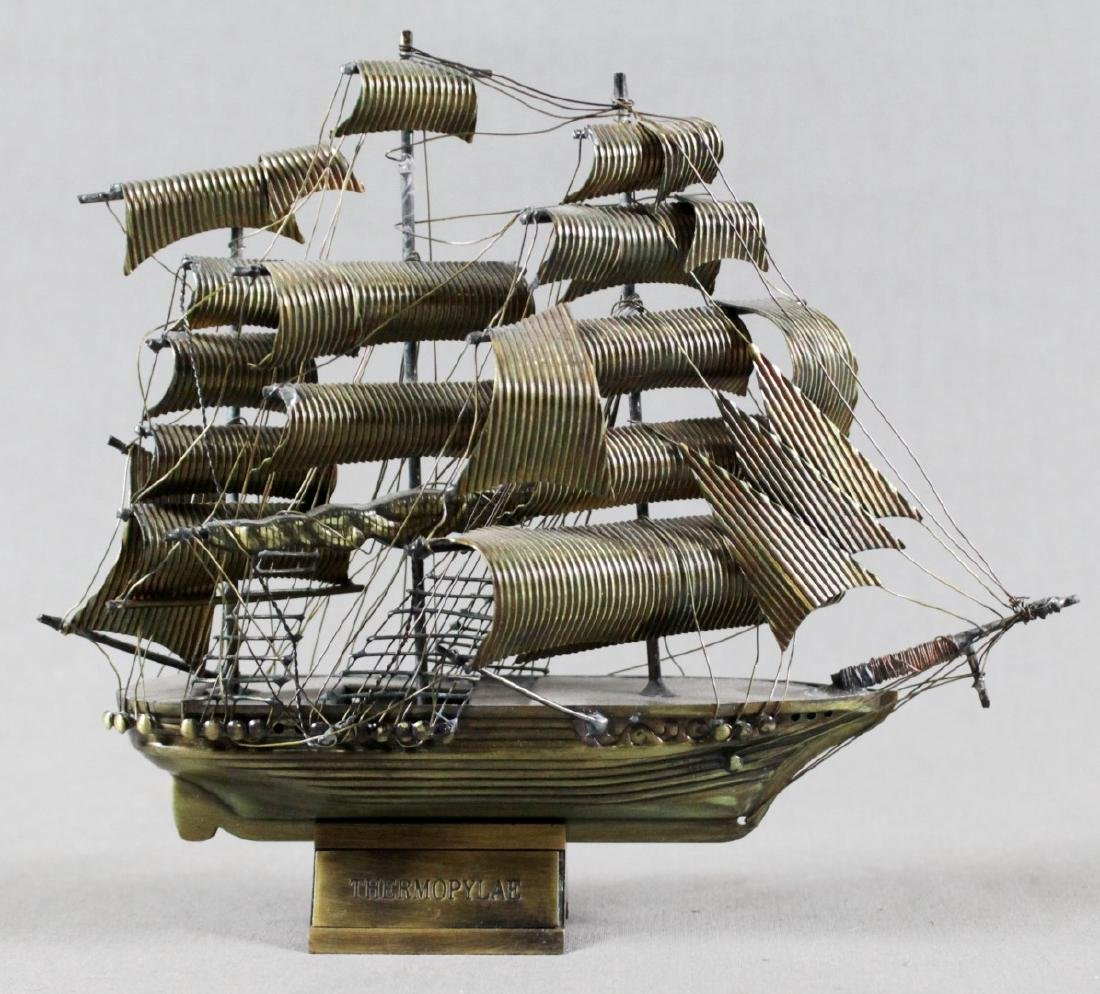 BRASS MINIATURE MODEL OF BOAT ON STAND