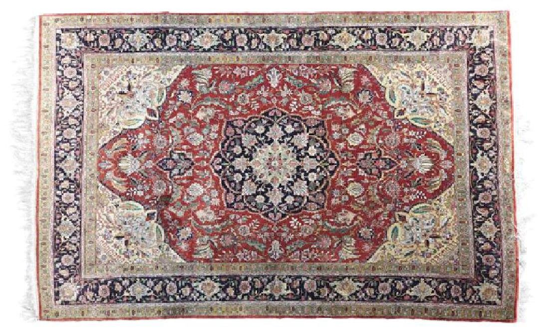 AN ISFAHAN SILK PERSIAN CARPET