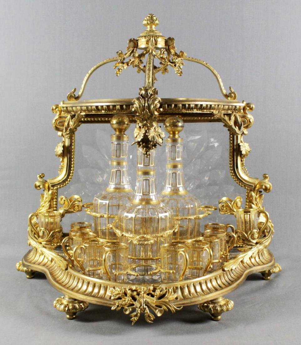 FRENCH GILT BRONZE AND CRYSTAL OPEN TANTALUS
