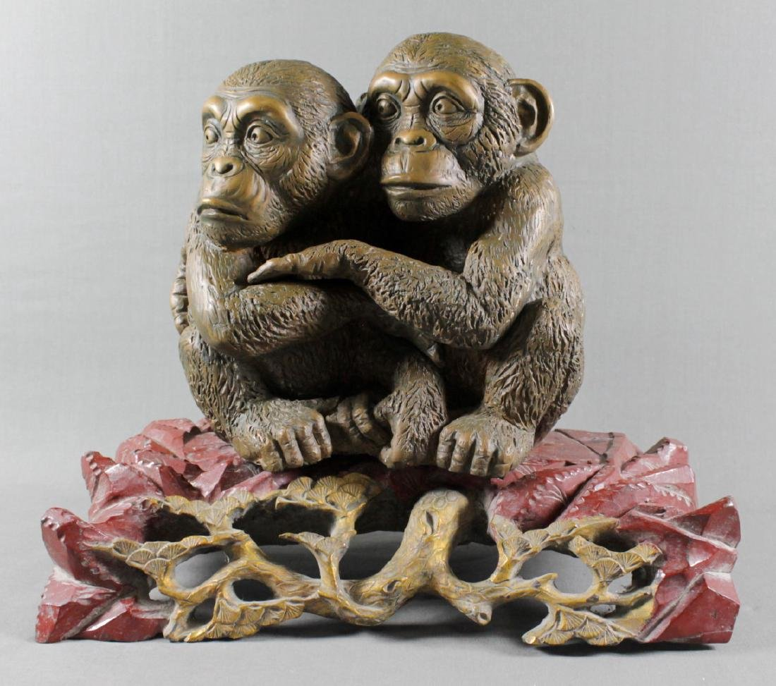 PATINATED BRONZE GROUP OF MONKEYS ON WOOD BASE