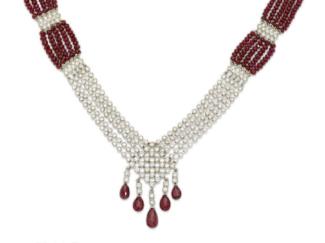 A COMPOSITE RUBY, DIAMOND AND WHITE GOLD NECKLACE