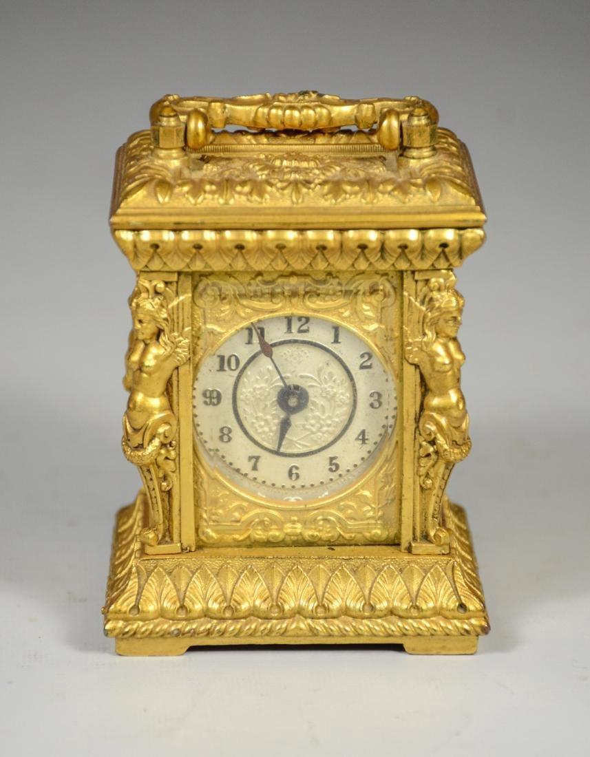 Continental gilt carriage clock, caryatid column