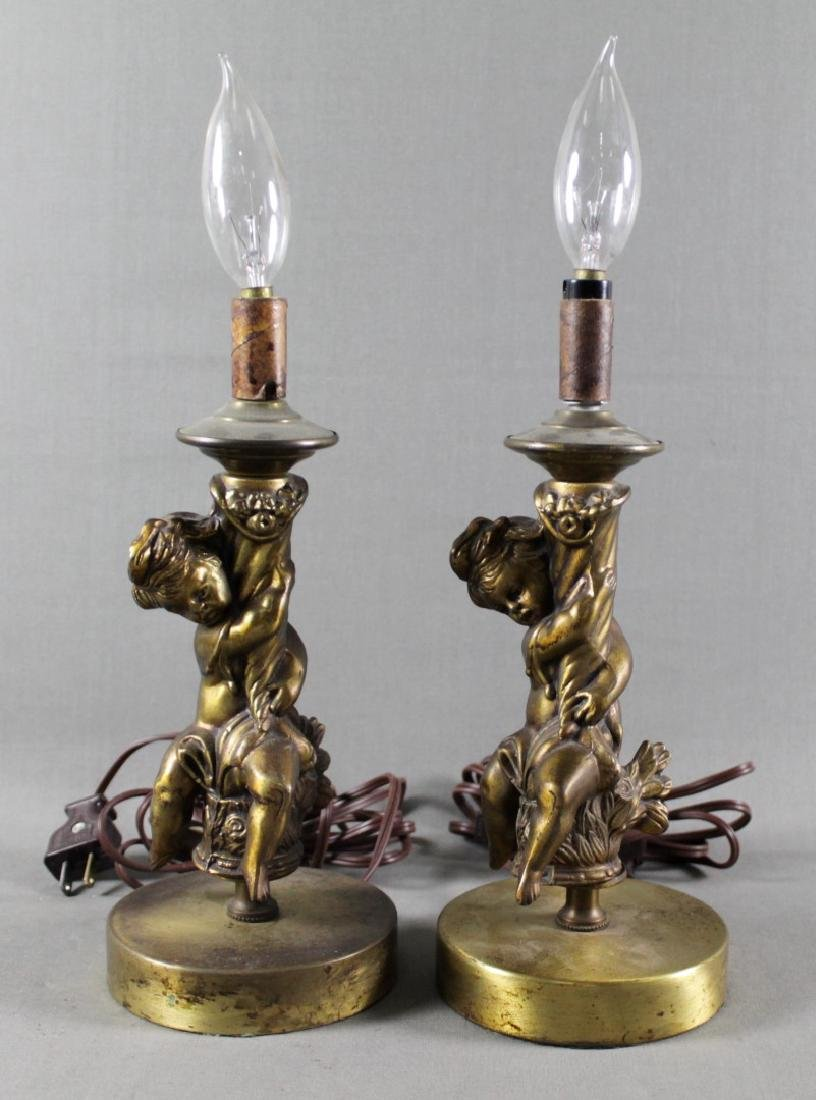 PAIR OF BRONZE CHERUB LAMPS
