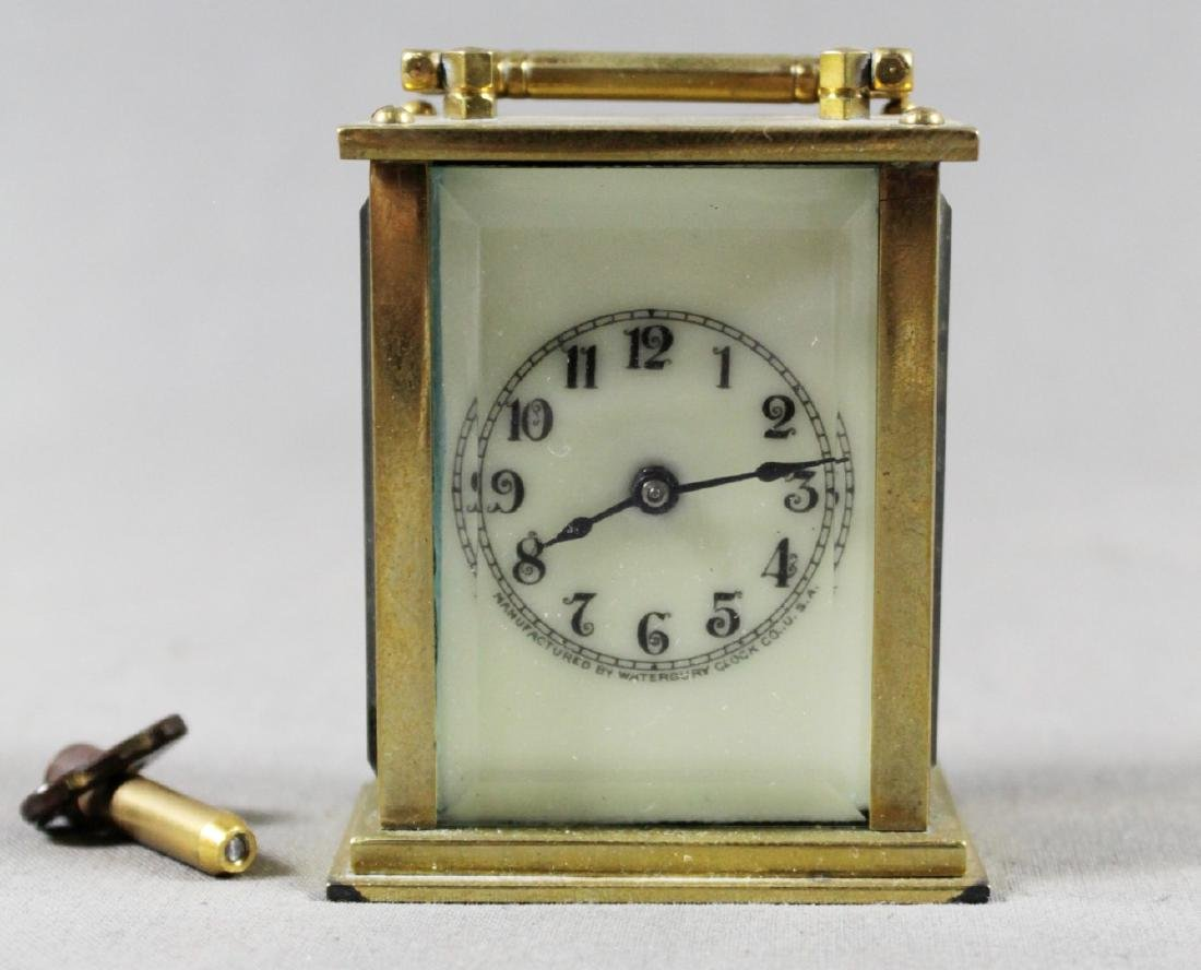 MINIATURE BRASS CARRIAGE CLOCK