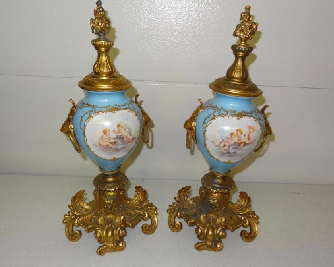 PAIR OF SEVRES STYLE PORCEAIN URNS