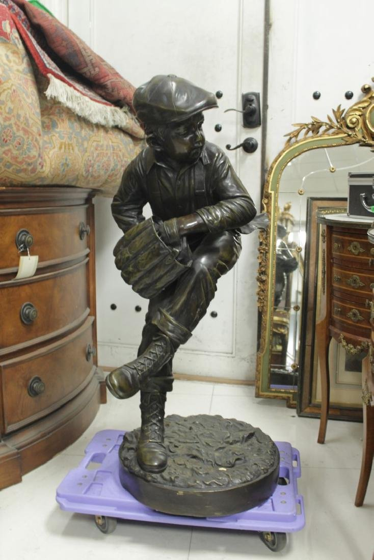 LARGE PATINATED BRONZE FIGURE OF A BASEBALL PLAYER