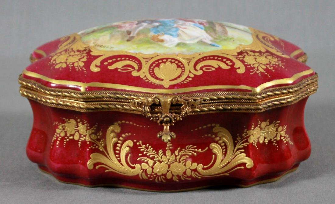 A Sevres Style Porcelain and Gilt Metal Mounted Box