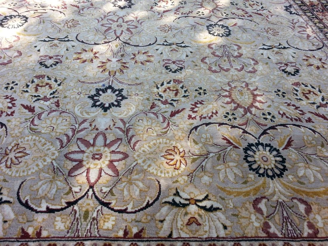 An INDO-PERSIAN 70 KNOTTED CARPET