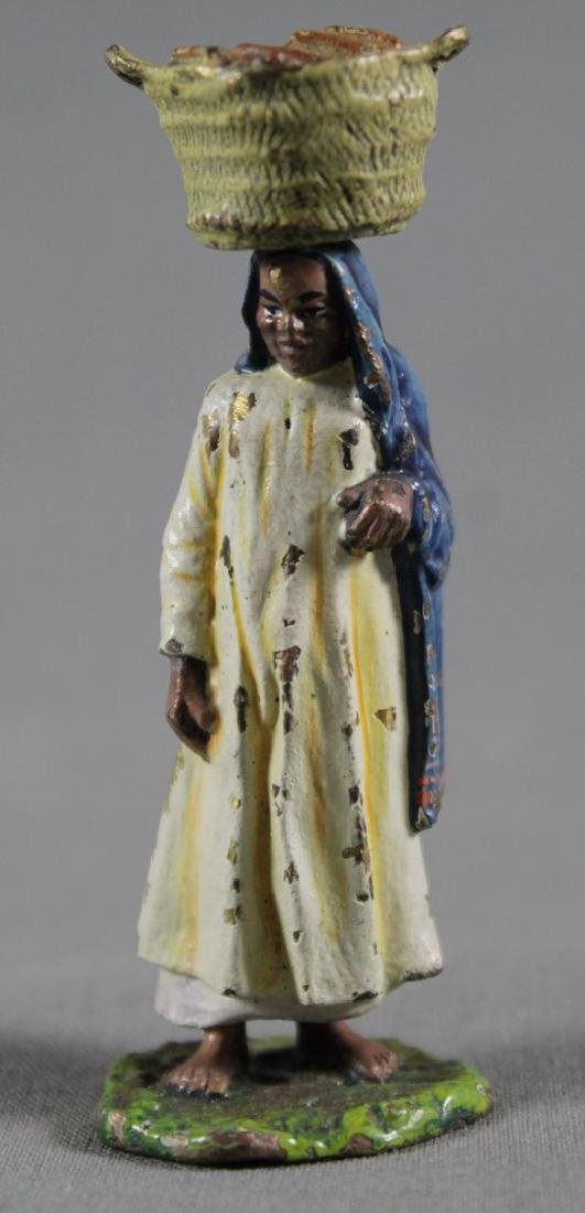 VIENNA STYLE COLD PAINTED FIGURE OF A WOMAN WITH FRUITS