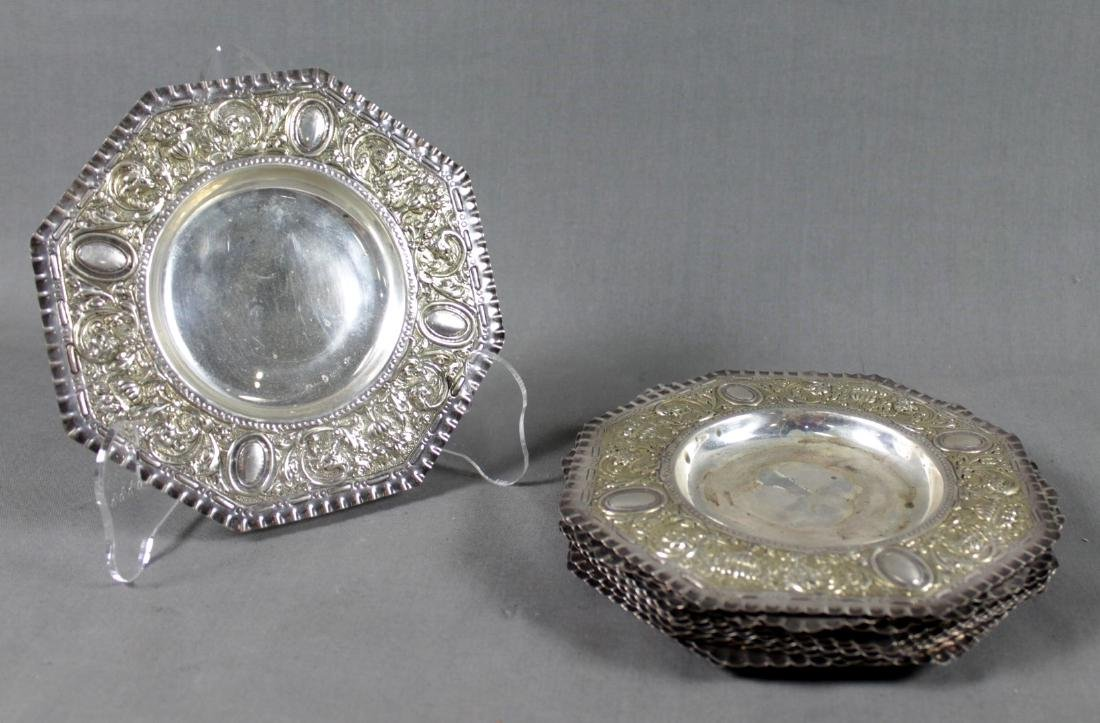 SET OF 12 REPOUSSE STERLING SILVER DISHES