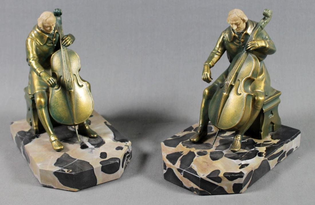PAIR OF FIGURAL BRONZE AND MARBLE BOOKENDS